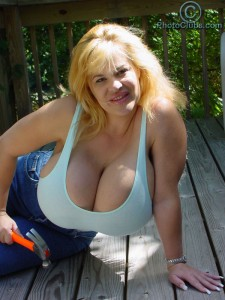 Crystal Storm showing her super large Breasts outdoors