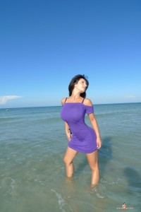 Purple gallery Denise Milani shows off heavy big boobs