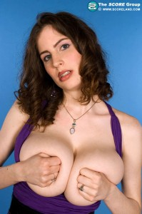 busty Lillian Faye likes to Cup her large Boobs Together by scorelnd.com