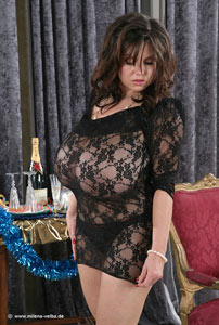 Milena Velba in a Fishnet outfit showing her Giant Boobs off photo