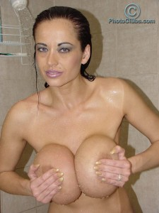Sexy babe Donita Dunes loves to play with her large Boobies