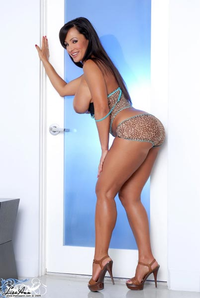 Several photos of busty superstar 38DD Lisa Ann