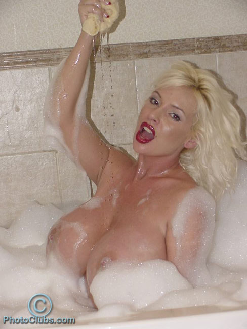 Wet huge tits, covered with foam