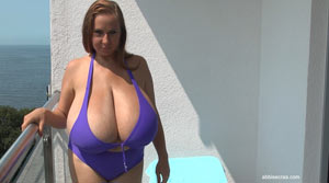 Abbi Secraa in Purple Bikini On Terrace