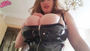 big breasts in vinyl dress